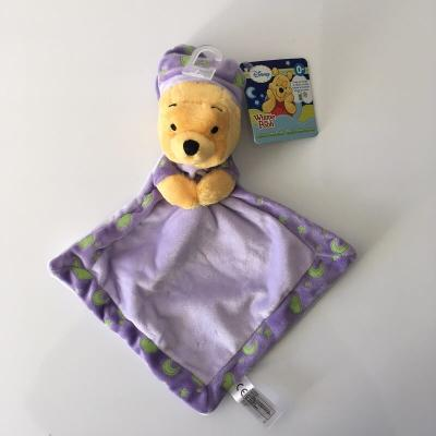 Doudou Winnie l'ourson Disney qui brille dans le noir